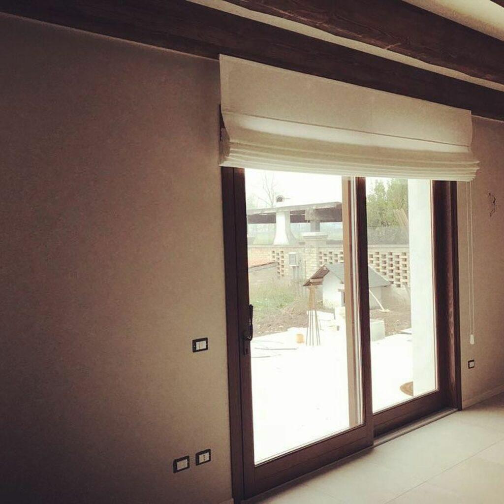 Bassi porte finestre scorrevoli legno e PVC Bagnolo Mella (Brescia)
